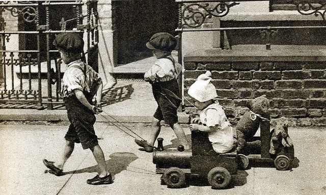 London in the 1920's, children with their toys (made of wood and metal).