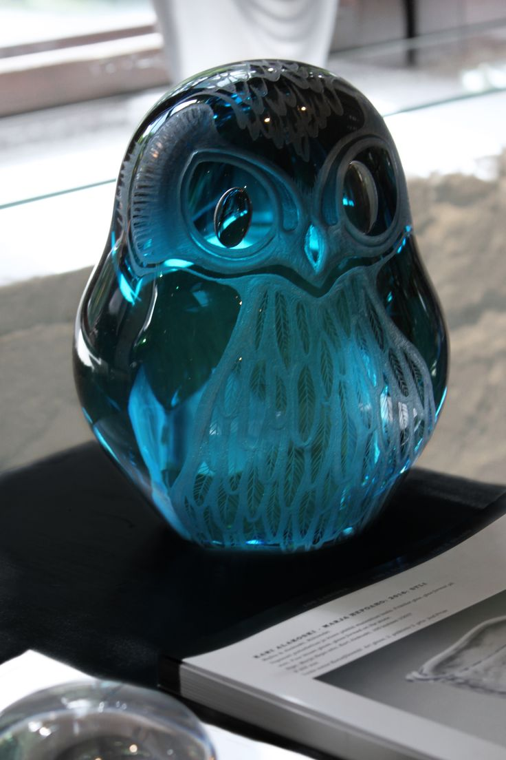 Owl glass sculpture by Mafka, glass artist Marja Hepo-aho. Mouth blown shape of an owl is brought to life with detailed engravings on the surface.