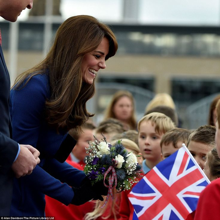 Kate, 33, shows her maternal side as she laughs and jokes with young schoolchildren: