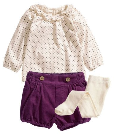 Set with top, shorts, and tights. Wide, long-sleeved top in soft jersey with polka dots, ruffle trim at neck, and elasticized neckline and cuffs. Puffed shorts in narrow-wale corduroy with side pockets, elasticized waist and hems, and decorative buttons at front. Fine-knit tights with elasticized waistband.