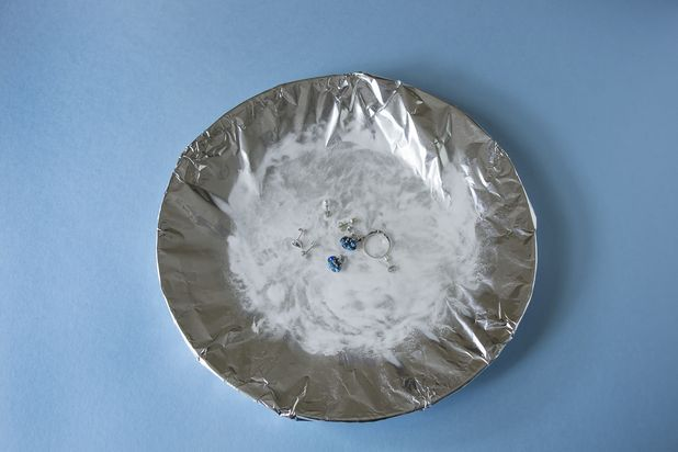 How to remove tarnish from costume jewelry - foil, 1 tbsp baking soda, 1 tsbp salt, 1-2c hot water