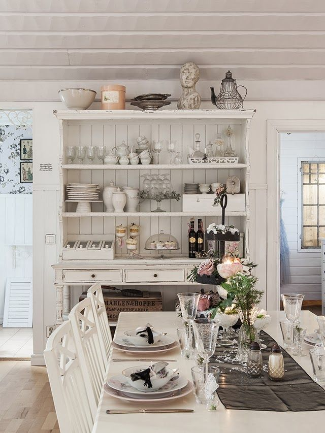 Beautiful design & styling—love many of the pieces in this kitchen, esp the glass decanters.