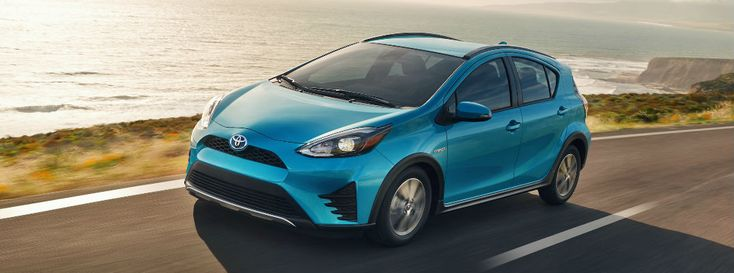 Turquoise 2018 Toyota Prius c on Coast Highway with Water in background