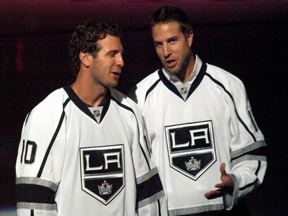 "Mike Richards and Simon Gagne in LA Kings jerseys. Simon was asked, ""Which LA King are you most looking forward to playing with?"" He answered, ""Justin Williams"".  Mike answered, ""Gags."""
