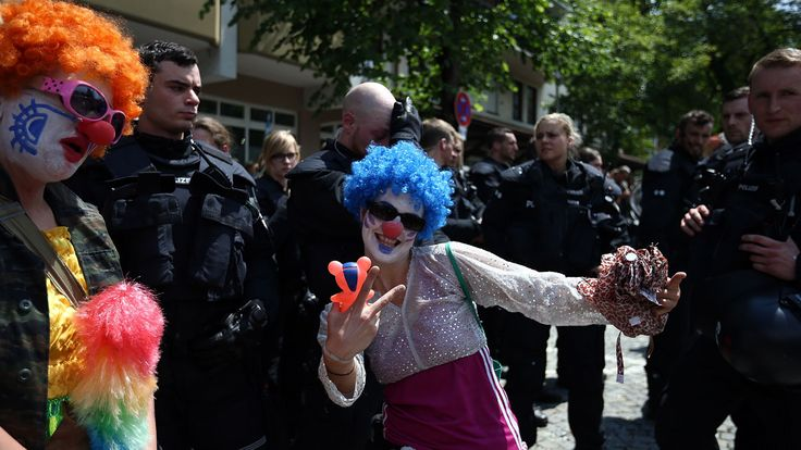 G7 summit protesters send in the clowns — but how could they tell the clowns from the sumitteers?