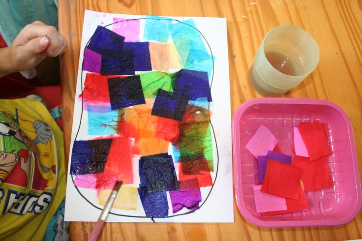 Crepe Paper process art activity.  Dye transfer from tissue/crepe paper onto card underneath by brushing with water.