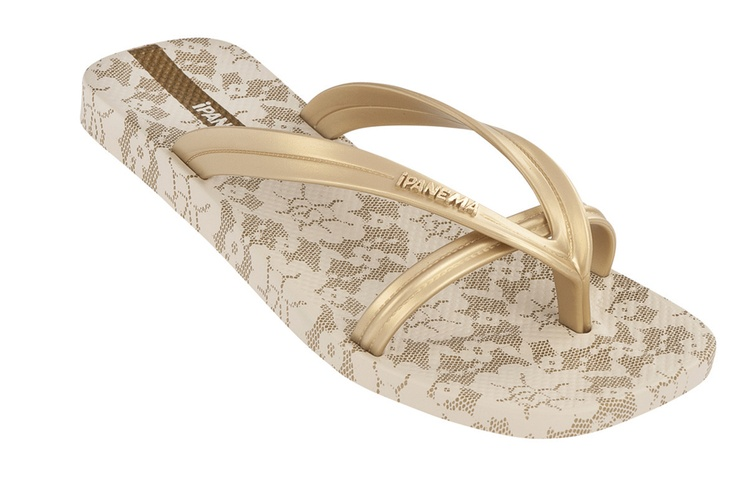 The Bright flop flop in gold. Twin straps with all-over lace effect print