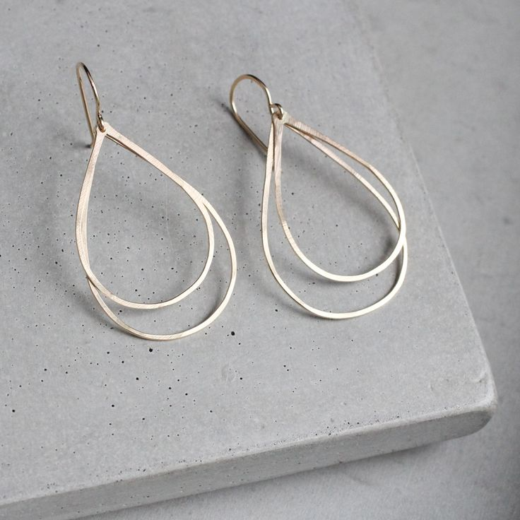 """Two featherweight teardrops are connected to handmade earrings hooks, they might move or sway, but never flip. About 1 1/2"""""""