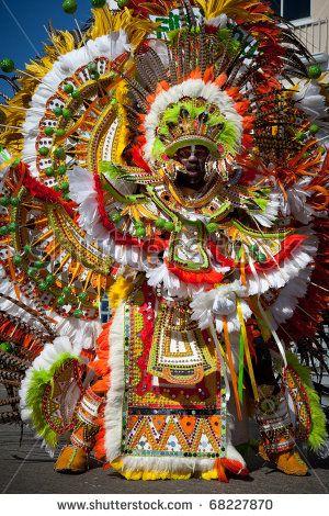 NASSAU, THE BAHAMAS - JANUARY 1 - Male troop leader dances in Junkanoo, a cultural festival on Jan 1, 2011 in Nassau by jo Crebbin, via ShutterStock