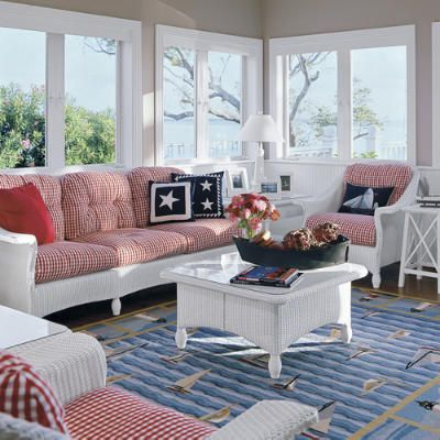 Patriotic sun room.  Red gingham cushions, white wicker furniture, navy pillows