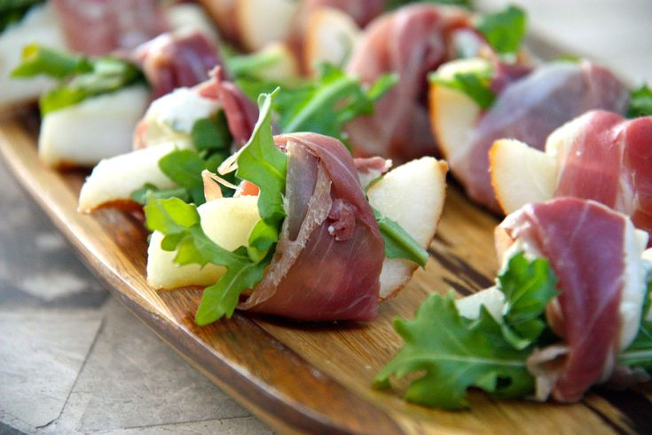 Sliced Pear with Goat Cheese Pistachio Cranberry and Arugula Tied Up with Prosciutto