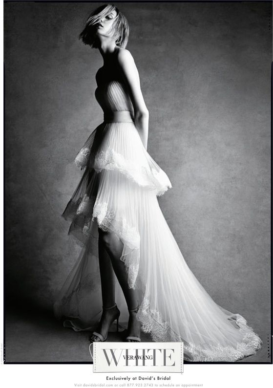 A wedding bridal dress featuring a tiered skirt from White by Vera Wang