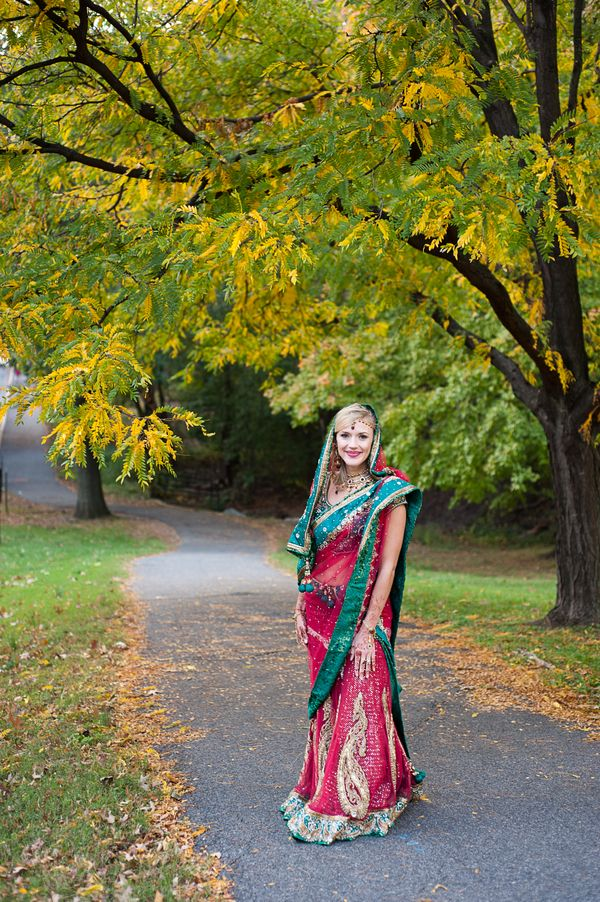 "This is what an Indian wedding outfit would look like. The lady is wearing a traditional sari, an outfit an Indian bride would wear. Since my family is indian, if I opted to go ""indian"" for my wedding, I would wear something like what she's wearing."