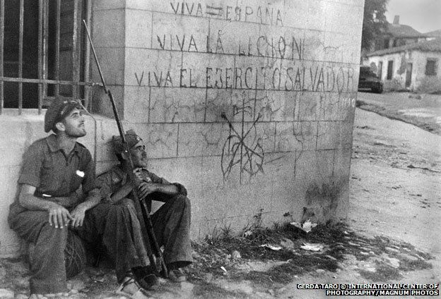Brunete 1937 - the wall next to these Republican is covered with Nationalist slogans and symbols : Gerda Taro: The forgotten photojournalist killed in action