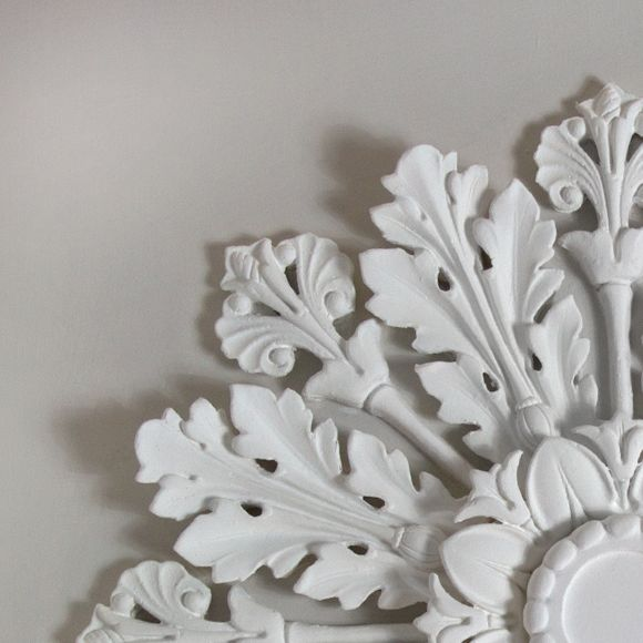 The Bexley is a very plush and handsome Victorian style plaster ceiling rose.  This lavish rose is handmade in 17 individual pieces.  Cast from face and back moulds, each component is highly detailed and heavily undercut.  Suitable for smaller rooms or hallways.  Dimensions:-  Diameter:-670mm  The plain centre section:-75mm  Depth:-30mm