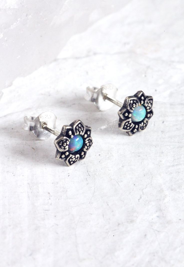 Flower sterling silver earrings features some dreamy white opal coloured stones. The white opal coloured stones has different flashes of colour...