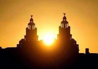 Sun setting over liverbirds