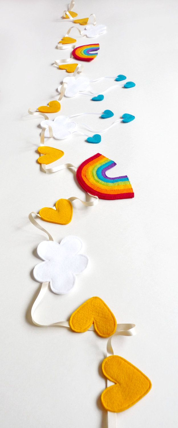 Use shapes as a mobile?  ---  Make a Rainbow - Felt Weather Bunting - Rainbow, Sunshine Hearts & Rain Cloud Wall Hanging / Room Decor - Christmas Gift Ideas for Children. £40.00, via Etsy.