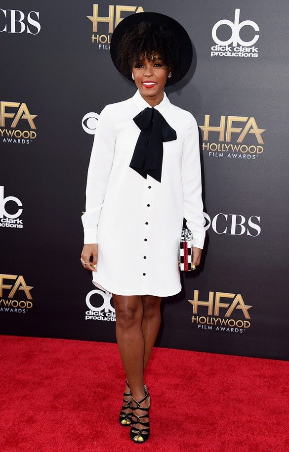 Janelle Monae in a black hat, Kate Spade tuxedo shirt style dress, and strappy heels at the Hollywood Film Awards.