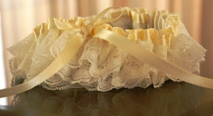 Beige satin with layers of lace. louise@heavenlygarters.co.za