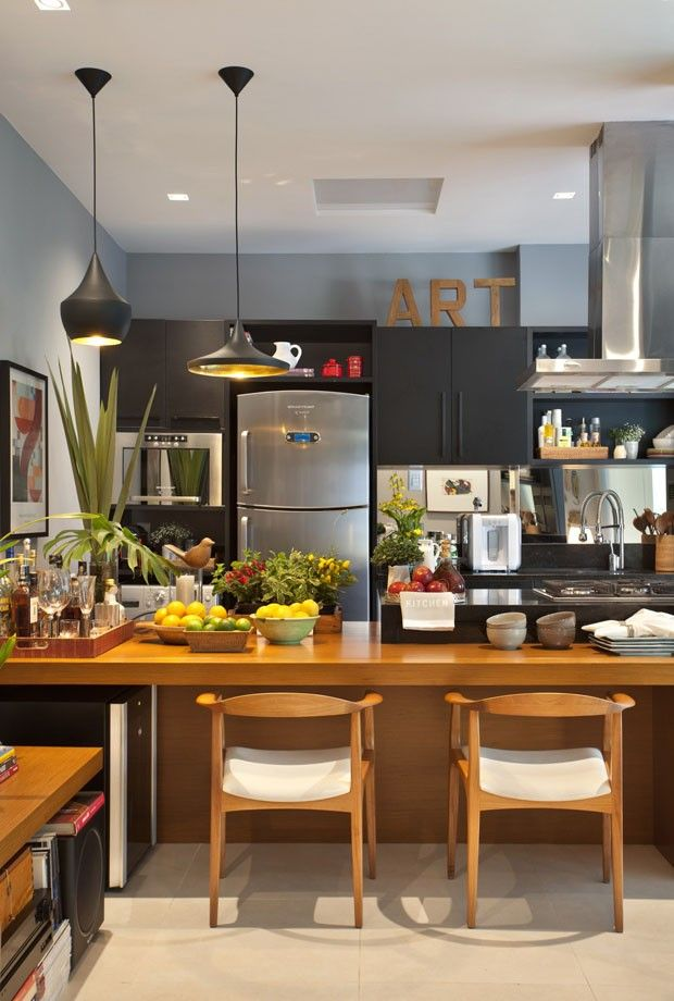 Modern kitchen natural wood and black cabinets mixed whit metal appliances