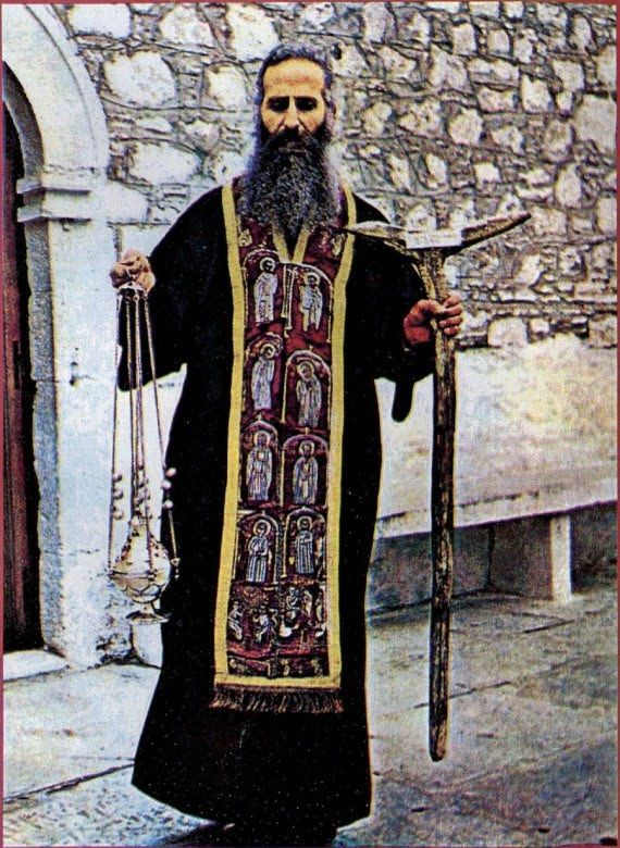 Picture of Elder Iakovos Tsalikis wearing the Epitrachelion of St. David the Righteous of Euboea, along with St. David's censer and his praying stick.