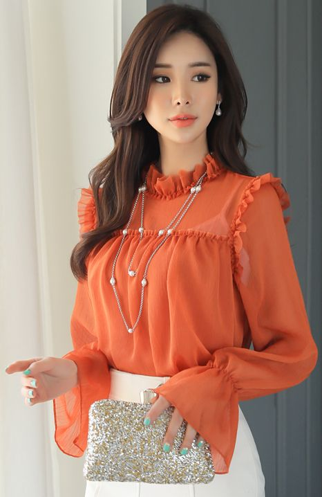Persimmon flouncy blouse w/ matching lips, waisted skirt, chestlength chocolate locks, minty nails, pearl pendant earrings, fair skin