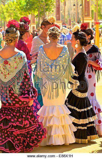 Group of women wearing traditional Spanish costume, Annual Horse Fair, Jerez de la Frontera, Cadiz Province, Andalusia, Spain - Stock Image
