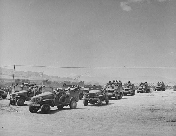 Reconnaissance and radio cars leading platoon of tank destroyers on training maneuvers in the desert
