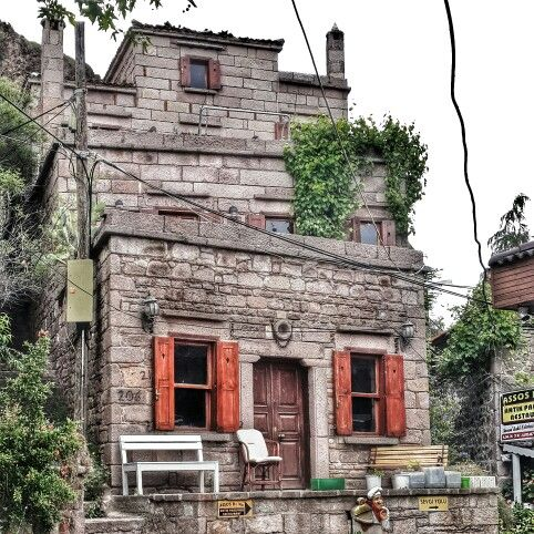 Assos port old stone house