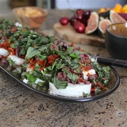 Best Ever Party Appetizer - Marinated Goat Cheese w/Sundried Tomatoes, Kalamata Olives, & Basil. Serve w/crusty french bread.