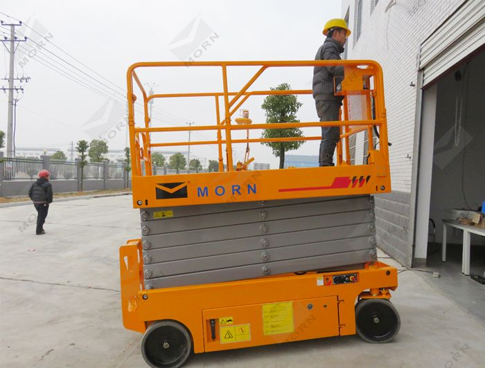 Sloping test of 12m electric scissor lift