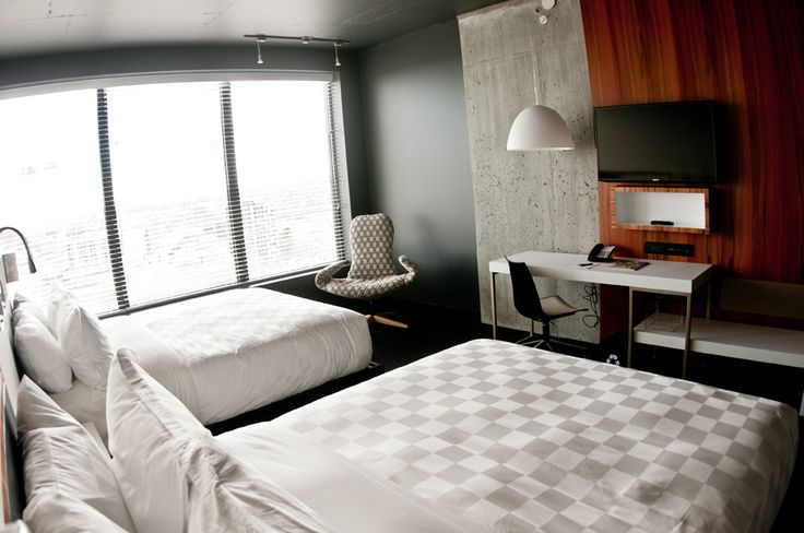 LEMAYMICHAUD | ALT | MONTREAL | Architecture | Design | Hospitality | Hotel | Lobby | Reception | Griffintown | Room | Bed | Bedding | Chair | Concrete | Window | Desk | Wood | Lighting