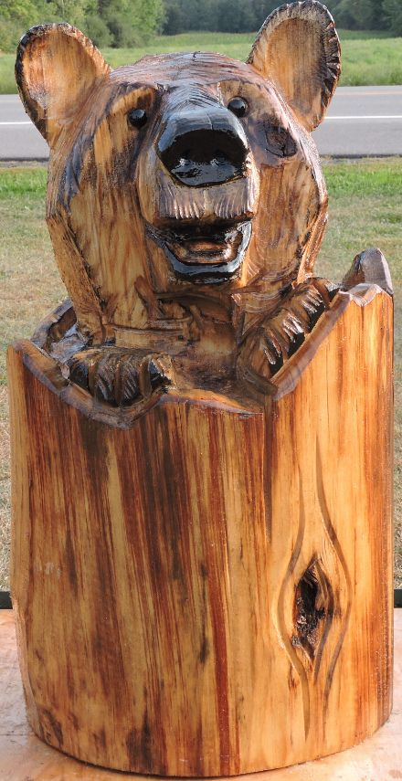Bear in log chainsaw carving lawn decoration