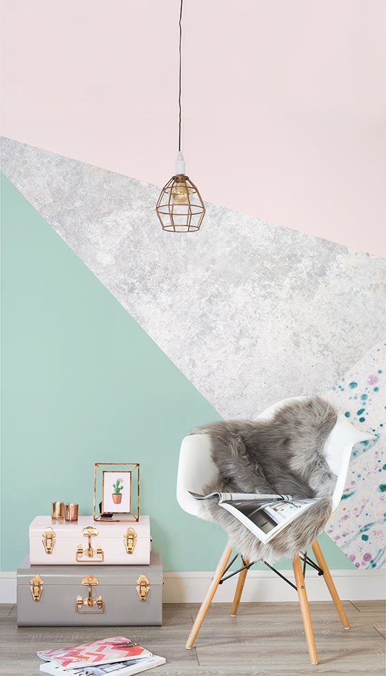 Eclectic Geometrics. Sleek lines meet pastel pink, marble and seafoam green to give a stunning wallpaper design. Pair with copper accents for an ultramodern living room space with added glam.