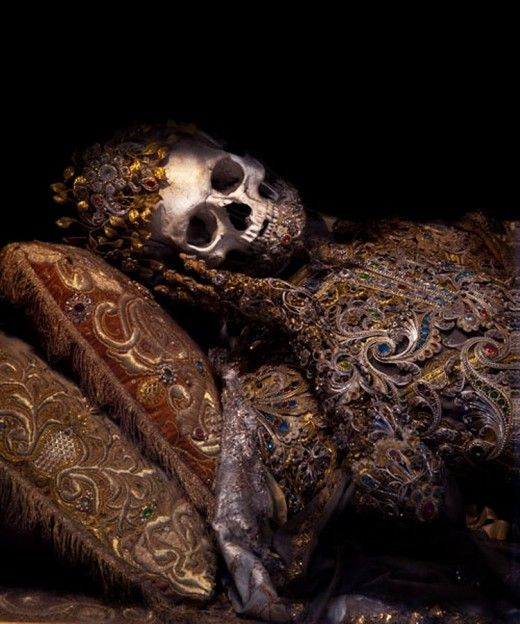 Jeweled skeletons from the 1600's, taken from the catacombs of Rome in the 17th century, the relics of twelve martyred saints were then attired in the regalia of the period before being interred in a remote church on the German/Czech border..for Caroline and Jami :)