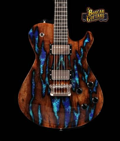 http://www.boxcarguitars.com/collections/knaggs-guitars