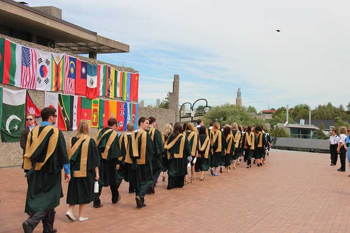 Wednesday, June 4, 2014 - 2:00 p.m. Ceremony Students processing past flags representing their home countries.