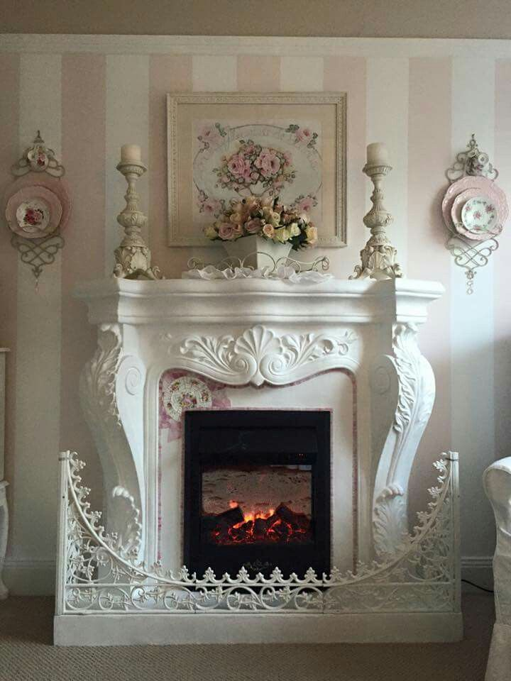 Beautiful fireplace. I would get a more simple fire guard as it detracts from the fireplace.