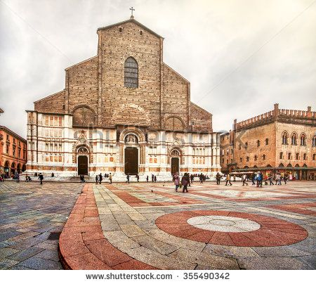 "Bologna, Italy - December 6, 2014: the San Petronio basilica facade  and the ""pavaglione"" flooring of Piazza Maggiore"