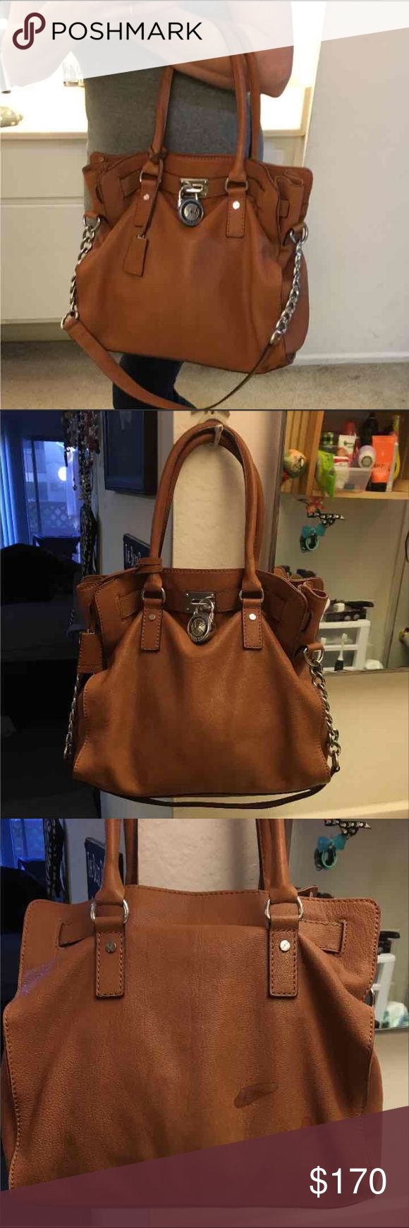 Like new authentic Michael Kors large Hamilton Super cute like new condition large size Hamilton used for like a month very clean inside has a few spots on leather from where nail polish remover splashed on it by accident pics up but the front of the purse is perfect so not noticeable when wearing lots of room let me know if you need more pics its a tan color with silver accessories that would go with anything original price $400 let me know if you have any questions or need more pics…