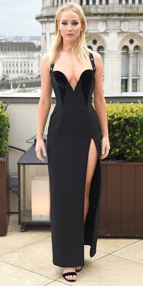 Jennifer Lawrence made jaws drop in a Versace dress with a daring slit and plunging neckline.