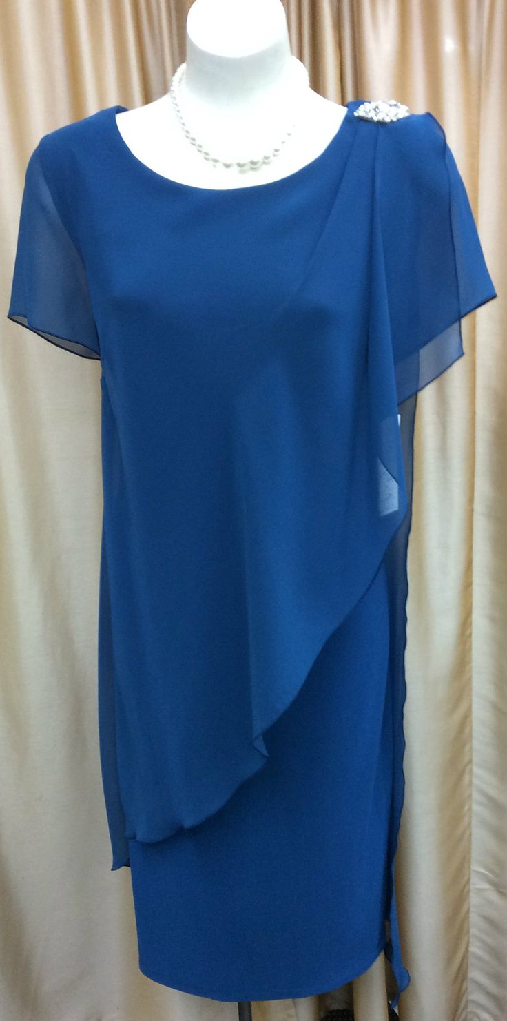 Jersey fabric Chiffon overlay Diamante on the shoulder Colour: Teal Size: 20