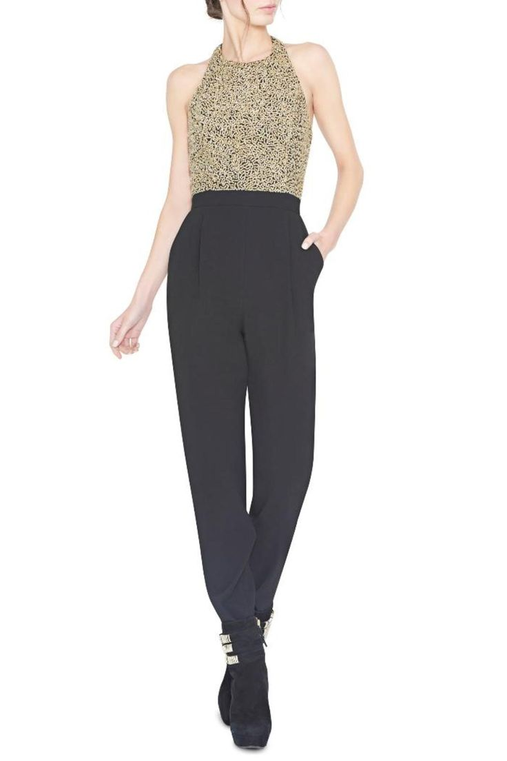 This statement jumpsuit from Alice  Olivia features an embellished bodice with a leather t-back detail.  Measurements: Inseam is approximately 27''  Jeri Embellished Jumpsuit by Alice  Olivia. Clothing - Jumpsuits & Rompers - Jumpsuits Canada