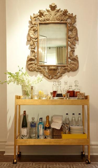 Bar cart vignette with vintage wood mirror
