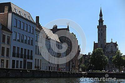 View of Jan Van Eyck Square with the Poortersloge tower and the Jan Van Eyck statue.