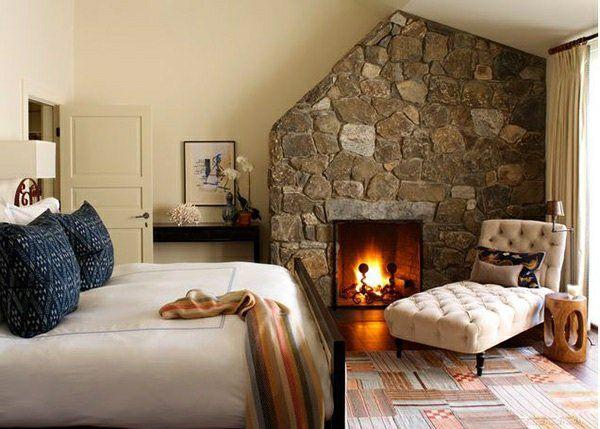 schlafzimmer ideen traditioneller stil steinwand kamin