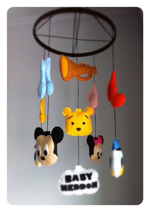 Or this mobile with all the best classic characters.   33 Perfectly Subtle Ideas For Your Disney-Themed Nursery-- Try to sew some for parks? small world faces, tiki room statues, etc.