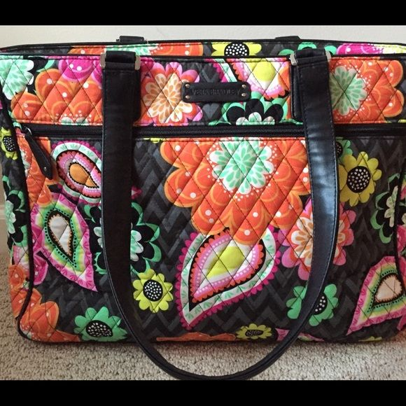 Vera Bradley Laptop Tote and Overnight Bag Beautiful bag in Ziggy Zinnia. Used for one business trip. Holds your laptop and several folders or clothes. Slips over a suitcase handle. Lots of pockets. It is in excellent condition. Great for work or a college student. Non smoking home. Vera Bradley Bags Laptop Bags