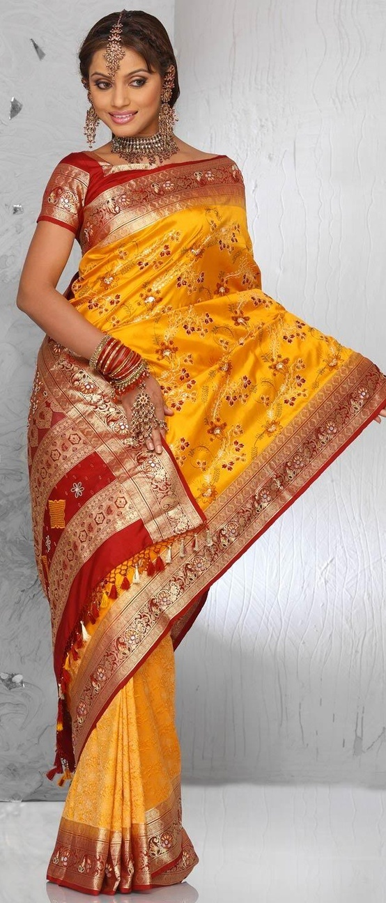 So pretty yellow and red Saree with golden borders Indian Wedding Dresses - http://www.kangabulletin.com/online-shopping-in-australia/bollywood-fashion-australia-discover-a-striking-collection-of-indian-clothes/ #bollywood #fashion #australia #sale indian fashion jewelry and saree online